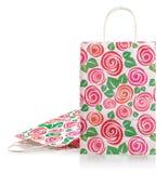 Dwa kolorowej prezent torby odizolowywającej na bielu Obraz Royalty Free