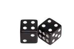 Dwa kostka do gry pokazuje dwa cztery Fotografia Stock