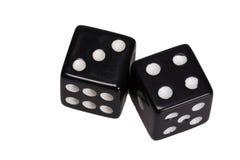 Dwa kostka do gry pokazuje trzy i cztery Obrazy Royalty Free