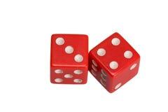 Dwa kostka do gry pokazuje trzy i cztery Zdjęcia Stock