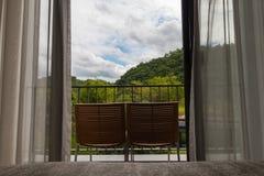 Dwa krzesła przy balkonem Fotografia Royalty Free