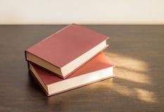 Dwa książki na drewno stole Fotografia Stock