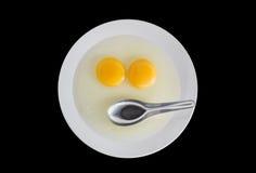 Dwa kurczaka Surowego jajecznego yolks i nierdzewnej łyżka w białym naczyniu Fotografia Royalty Free