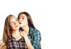 Dwa ?licznego nastolatka ma zabaw? wp?lnie odizolowywaj?c? na bielu fotografia stock