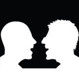 Dwa ludzie dyskutuje sylwetkę Obrazy Stock