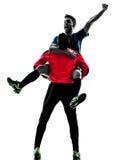 Dwa mężczyzna gracza piłki nożnej bramkarza świętowania sylwetka Zdjęcie Stock