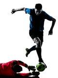 Dwa mężczyzna gracza piłki nożnej bramkarza rywalizacja zdjęcie stock