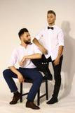 Dwa mężczyzna portret w wakacje sukni z hairdress Obraz Stock
