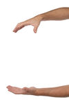Dwa męskiej ręki z przestrzenią stawiać coś Zdjęcia Stock