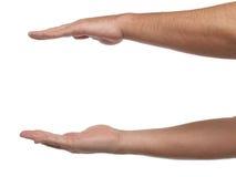 Dwa męskiej ręki z przestrzenią stawiać coś Zdjęcie Stock