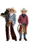 Dwa młodego kowboja jest ubranym kumpel trzyma comber i arkanę Obrazy Stock