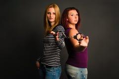 Dwa młodej kobiety z kajdankami obrazy royalty free