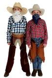 Dwa młodego kowboja z bandannas zakrywa ich twarze Obrazy Stock