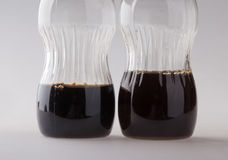 Dwa mała butelka z czarnym cieczem Obrazy Stock