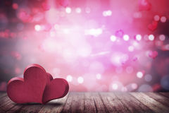 Dwa miłość kształt na drewnianej podłoga Zdjęcia Stock