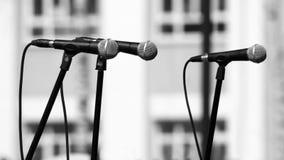 Dwa mikrofonu na budynku tle Obrazy Royalty Free