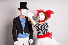 Dwa mima mężczyzna i kobieta Kwietnia durnia dnia pojęcie Zdjęcia Royalty Free