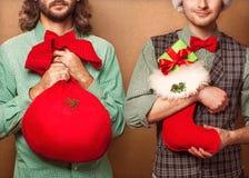 Dwa modniś w Święty Mikołaj Zdjęcie Royalty Free