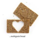 Dwa multigrain plasterka chleb z cięcia out kształtem serce Obrazy Stock