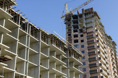 Dwa nowego budynku w różnorodnych scenach erekcja Zdjęcie Stock