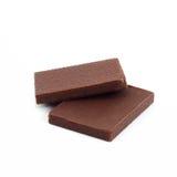 Dwa opłatka pokrywającego z czekoladą i odizolowywającego na bielu, Zdjęcia Stock
