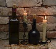 Dwa pary butelki i świeczki Obraz Royalty Free
