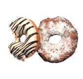 Dwa pasiastego donuts odizolowywającego na bielu Obrazy Stock