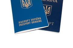 Dwa paszporta, cudzoziemski i Ukraiński na białym tle, kopii przestrzeń dla teksta obrazy stock