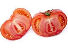 Dwa połówki rżnięty pomidor Fotografia Stock