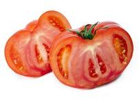 Dwa połówki rżnięty pomidor Obrazy Stock