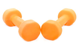 Dwa pomarańczowego dumbbells odizolowywającego na białym tle Obrazy Stock