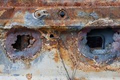 Dwa przez dziur w starym ośniedziałym samochodowym ciele Obraz Royalty Free