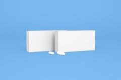 Dwa pudełka pigułki na błękitnym tle Fotografia Stock