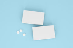 Dwa pudełka pigułki na błękitnym tle Zdjęcie Stock