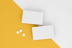 Dwa pudełka pigułki na koloru żółtego tle Zdjęcia Royalty Free