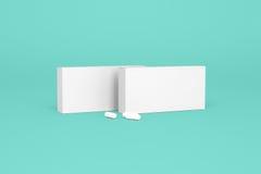 Dwa pudełka pigułki na turkusowym tle Zdjęcia Stock