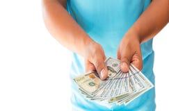 Dwa ręki trzyma dolarów amerykańskich rachunki odizolowywający na białym tle Zdjęcia Stock