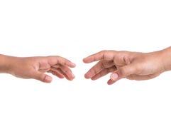 Dwa ręk próba dosięgać pojęcia pomoc odosobniony biel Odizolowywający na bielu Zdjęcia Royalty Free