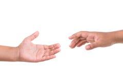 Dwa ręk próba dosięgać pojęcia pomoc odosobniony biel Odizolowywający na bielu Obrazy Royalty Free