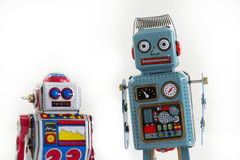 Dwa rocznika blaszanego zabawkarskiego robota odizolowywającego na białym tle Obrazy Royalty Free