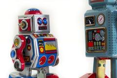 Dwa rocznika blaszanego zabawkarskiego robota odizolowywającego na białym tle Obraz Royalty Free