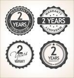 Dwa roku gwarancja rocznika retro odznaki i etykietki inkasowi ilustracja wektor