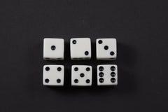 Dwa rzędu kostka do gry pokazuje liczby jeden, sześć Zdjęcie Stock