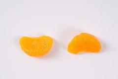 Dwa segmentu obrani tangerines Obrazy Stock