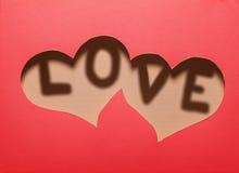 Dwa serc wycinanka w czerwień papierze z słowem Fotografia Royalty Free