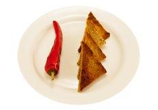 Dwa sercowata grzanka i korzenny czerwony pieprz Fotografia Stock