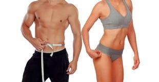 Dwa sprawności fizycznej bodies odizolowywającego na białym tle zdjęcie stock