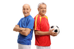 Dwa starszego gracza piłki nożnej patrzeje kamerę Zdjęcia Royalty Free
