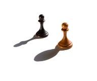 Dwa szachowego pionka jeden kasting biskupa kawałka cień Obrazy Royalty Free