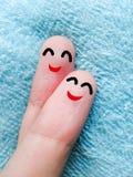Dwa szczęśliwego palca na błękitnej tkaninie fotografia stock